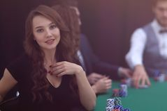 Modern business woman sitting at craps table in a casino. stock photos
