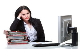 Modern business woman sitting at office desk Royalty Free Stock Images