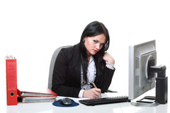 Modern business woman sitting at office desk Stock Photography
