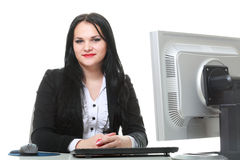 Modern business woman sitting at office desk Stock Photos