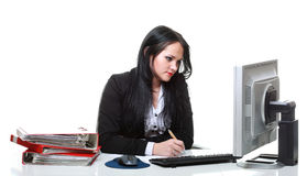 Modern business woman sitting at office desk Royalty Free Stock Photos