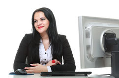 Modern business woman sitting at office desk Royalty Free Stock Image