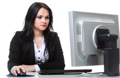 Modern business woman sitting at office desk Stock Photo