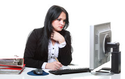 Modern business woman sitting at office desk Stock Image