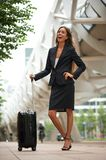 Modern business woman smiling with suitcase Royalty Free Stock Photo