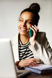 Modern business woman smiling and talking on cellphone Royalty Free Stock Photography