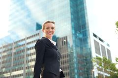 Modern business woman smiling and walking outside Stock Photography