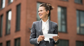 Modern business woman with tablet PC looking aside Stock Image