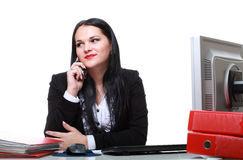 Modern business woman talking phone sitting at office desk Royalty Free Stock Image