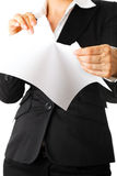 Modern business woman tearing sheet of white paper Stock Image