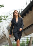 Modern business woman walking in the city Stock Photo