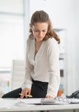 Modern business woman working in office Stock Photos