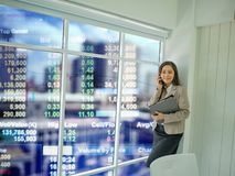 Modern business women use mobilephone talk about stock market royalty free stock photo