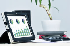 Modern business workplace. With digital tablet, calculator, pen Royalty Free Stock Images