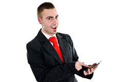 Modern businessman. Young businessman surfing the internet on his new tablet pc Stock Image