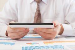 Modern businessman analyzing graphs Royalty Free Stock Photography