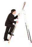 Modern businessman  climbing upwards up on ladder Royalty Free Stock Images