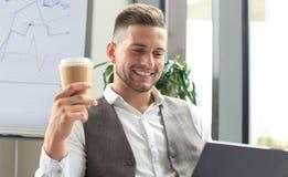 Modern businessman drinking coffee Royalty Free Stock Photos