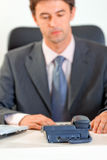 Modern businessman expecting phone call. Royalty Free Stock Photography