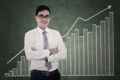 Modern businessman and financial graph Stock Photos