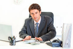 Modern businessman giving money packs Stock Image