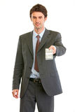 Modern businessman giving stack of dollars Stock Images