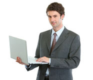 Modern businessman with laptop Royalty Free Stock Images