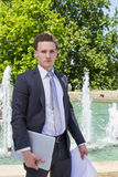Modern businessman with laptop and papers. Outside Royalty Free Stock Images