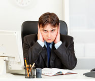 Modern businessman making hear no evil gesture Royalty Free Stock Photo