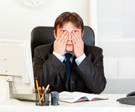Modern businessman making see no evil gesture Stock Photos