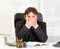 Modern businessman making speak no evil gesture Stock Photo