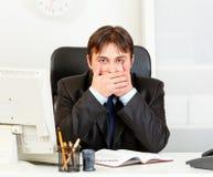 Modern businessman making speak no evil gesture Stock Photo