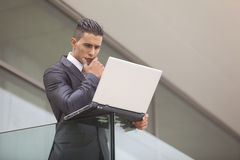 Modern businessman at the office balcony Stock Photography