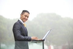 Modern businessman at the office balcony Stock Photos