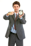 Modern businessman pointing on alarm clock Royalty Free Stock Photos