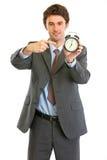 Modern businessman pointing on alarm clock Royalty Free Stock Photos