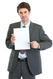 Modern businessman pointing on blank paper sheet Royalty Free Stock Photo