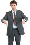 Modern businessman pointing down Stock Images
