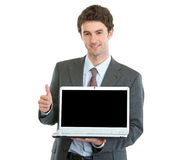 Modern businessman showing laptops blank screen Stock Image