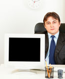 Modern businessman showing monitors blank screen Royalty Free Stock Image