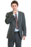 Modern businessman showing shh gesture Stock Image