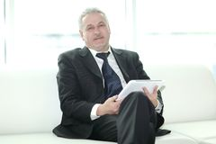 Modern Businessman Sitting In Office Lobby.people And Technology Stock Photo