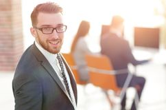Modern businessman standing in office. Royalty Free Stock Photos