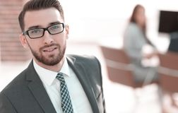 Modern businessman standing in office. Business background royalty free stock image