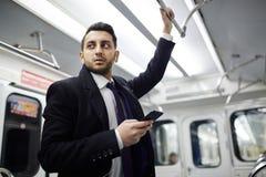 Modern Businessman in Subway Train stock photography