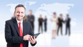 Modern businessman using tablet Stock Images