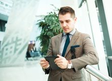 Modern businessman using tablet computer Royalty Free Stock Photography