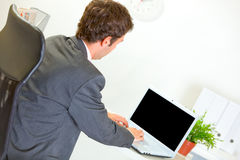Modern businessman working on laptop Royalty Free Stock Image