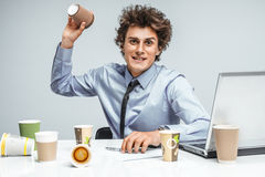 Modern businessman at the workplace working with computer. Mad tired manager / modern businessman at the workplace working with computer, depression and crisis Royalty Free Stock Image