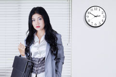 Modern businesswoman with briefcase in office Royalty Free Stock Image